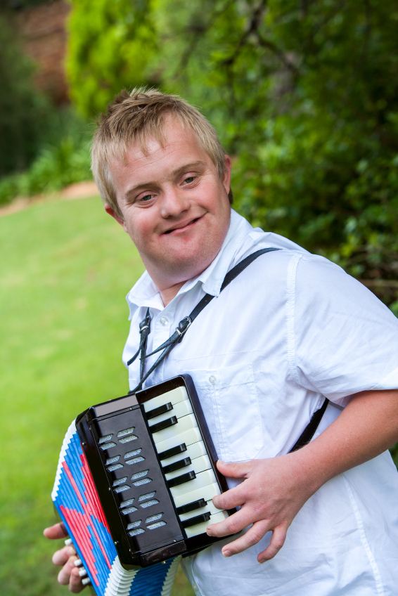 Handicapped boy playing the accordion.